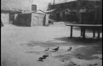 """Courtyard on Gorbatyi Lane. The foster girls could look into the courtyard through the grilled window in the wall on the left-hand side. Photo: Mikhalskaya N. P. """"The River Flows..."""" M., 2005."""