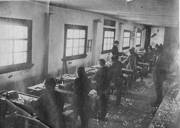 "Boys doing woodwork in the orphanage. Photograph: ""Siniaia ptitsa"""